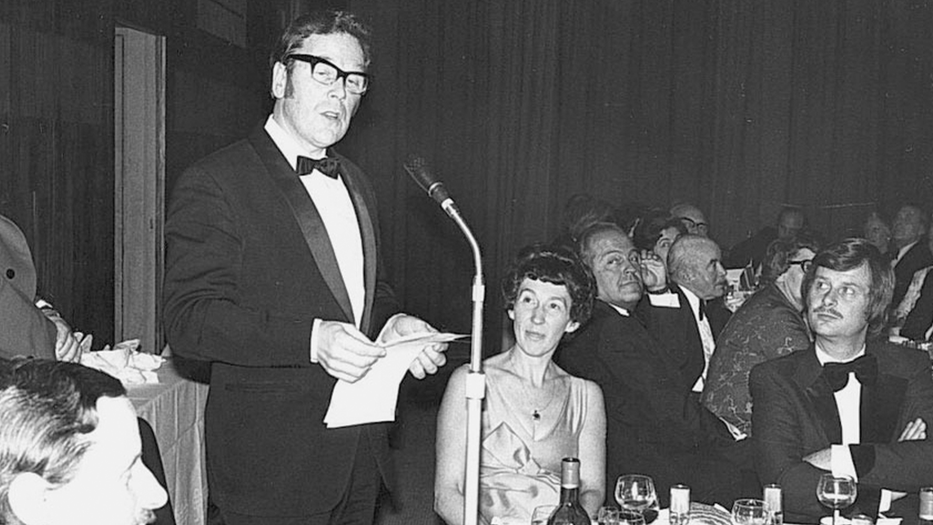 Laurie Foster welcomes guests at the Annual Dinner in 1976